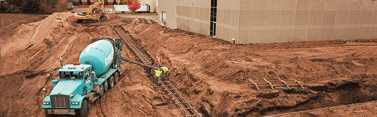 Pouring Concrete foundation for KEB America's building expansion